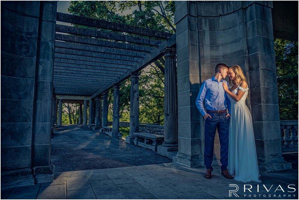 Romantic Spring Engagement Session | A dramatic picture of an engaged couple embracing at Kansas City's Colonnade.