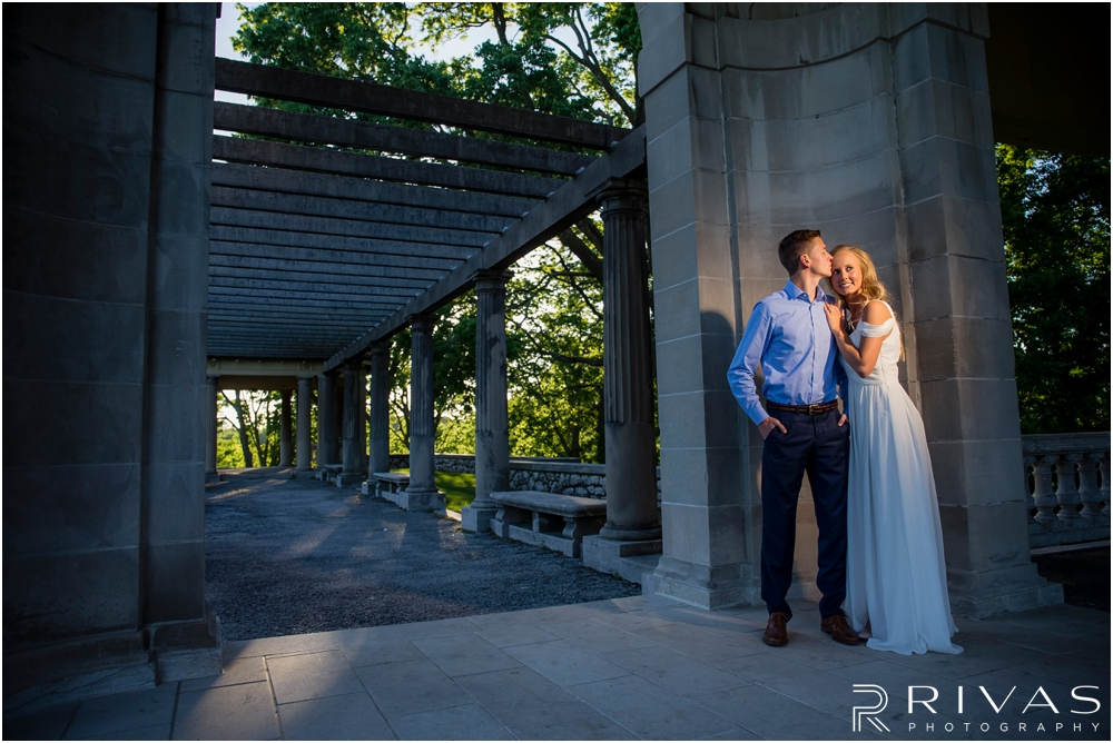 Romantic Spring Engagement Session | A picture of an engaged couple embracing at Kansas City's Colonnade.