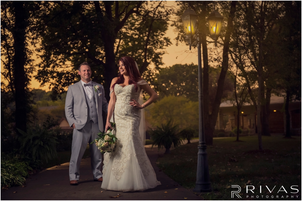 Rustic Fall Wedding Sneak Peek | A dramatic picture of a bride and groom just after their wedding ceremony during sunset, standing underneath a street light at The Elms.