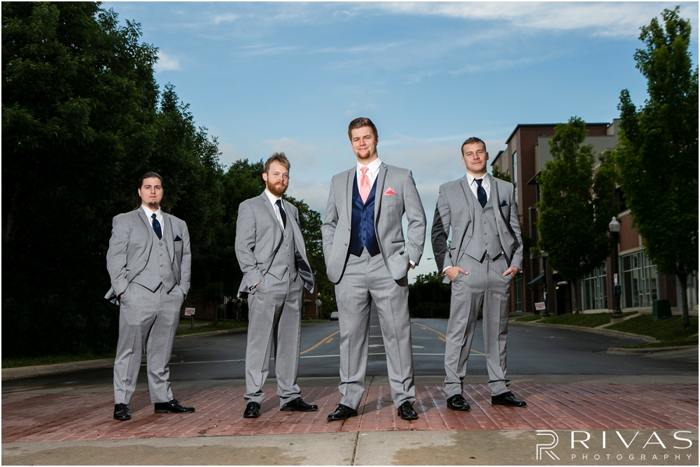 St. John the Evangelist Catholic Church Spring Wedding | A candid picture of a groom and his groomsmen standing in a Lawrence street.
