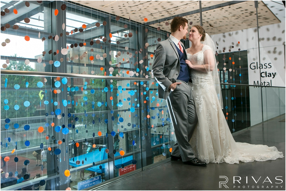 St. John the Evangelist Catholic Church Spring Wedding | A photo of a bride and groom embracing at the Lawrence Arts Center.