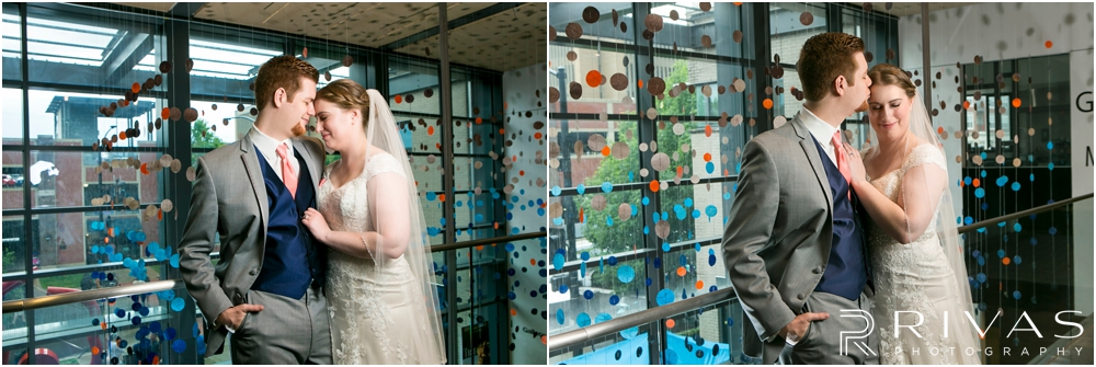 St. John the Evangelist Catholic Church Spring Wedding | Two pictures of a bride and groom embracing at the Lawrence Arts Center.