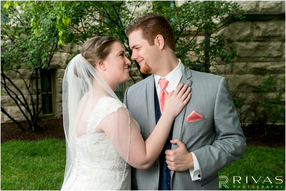 St. John the Evangelist Catholic Church Spring Wedding | A close-up image of a bride and groom embracing outside the courthouse in Lawrence, KS on their wedding day.