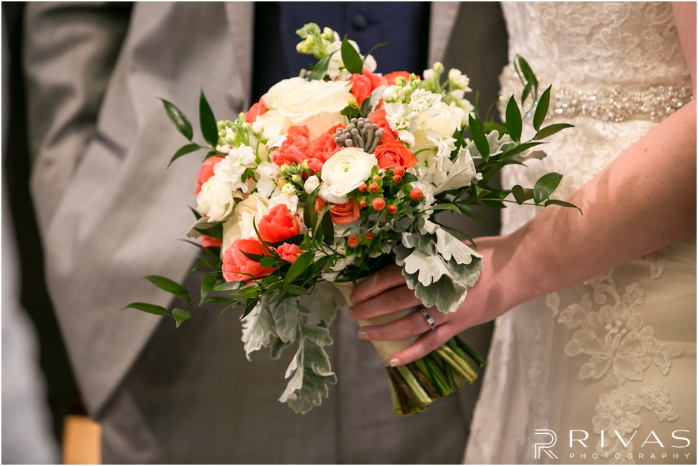 St. John the Evangelist Catholic Church Spring Wedding | A close-up picture of a bride holding her bouquet on her wedding day.