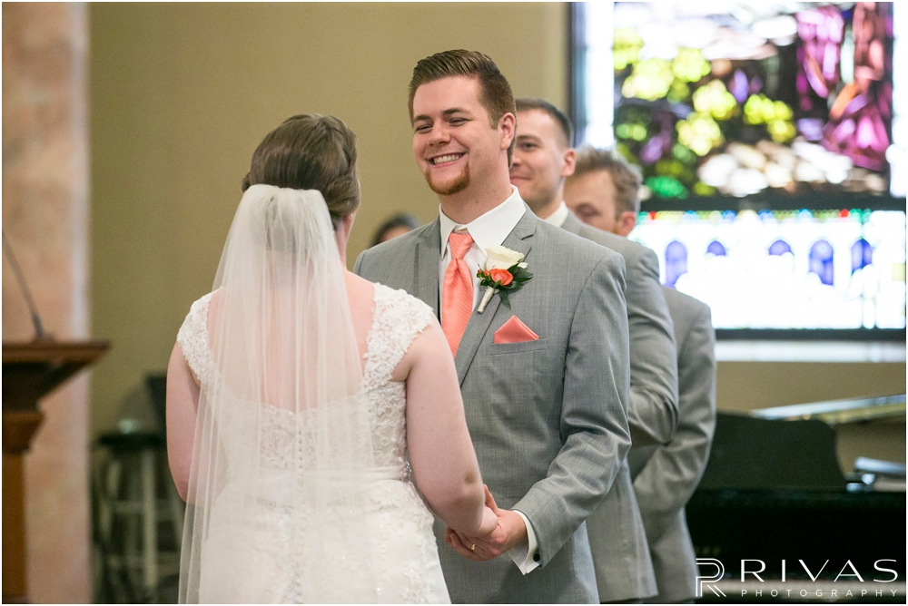 St. John the Evangelist Catholic Church Spring Wedding | A candid image of a groom saying his vows to his bride during their wedding ceremony.
