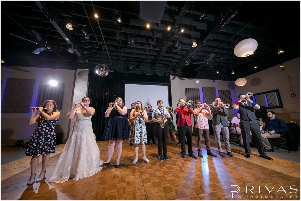 St. John the Evangelist Catholic Church Spring Wedding | A candid picture of a surprise performance by the KU Pep band at a wedding reception in Lawrence, KS.