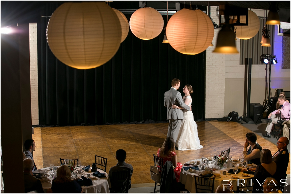 St. John the Evangelist Catholic Church Spring Wedding | A photo of a bride and groom sharing their first dance during their wedding reception at Maceli's in Lawrence, KS.