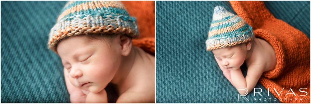 Turquoise Themed Newborn Session | Photo of newborn baby girl laying on turquoise backdrop with multi-colored knit hat