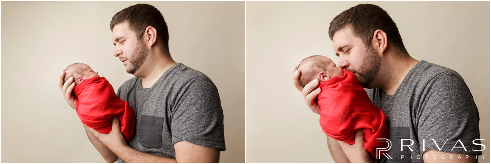 Turquoise Themed Newborn Session | Photo of newborn baby girl wrapped in red with her dad.