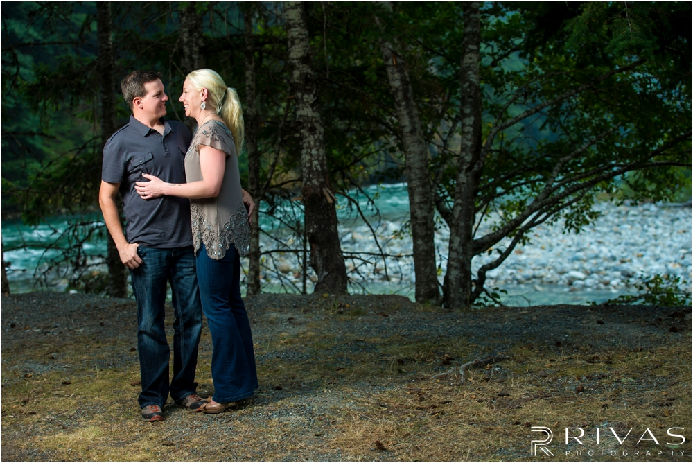 Diablo Lake Engagement Session | A photo of an engaged couple embracing in front of aspen trees at Diablo Lake, Washington.