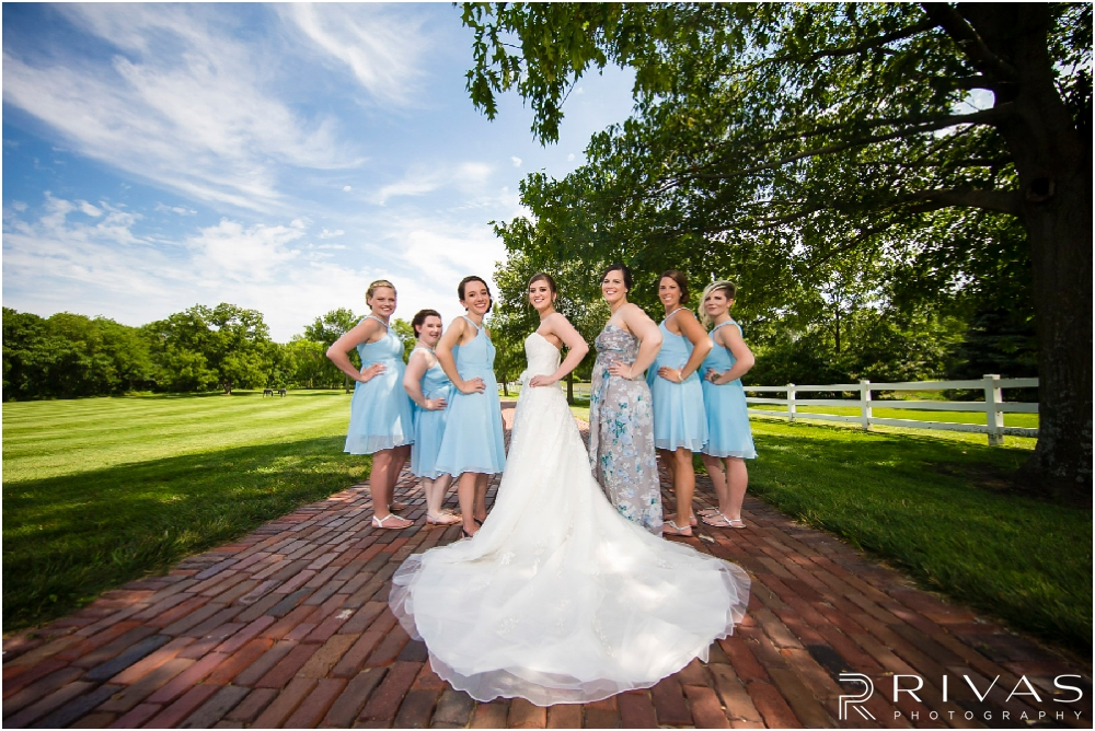 Mildale Farm Summer Wedding | A photo of a bride and her bridesmaids in capri blue gowns on the grounds of Mildale Farm before a summer wedding.