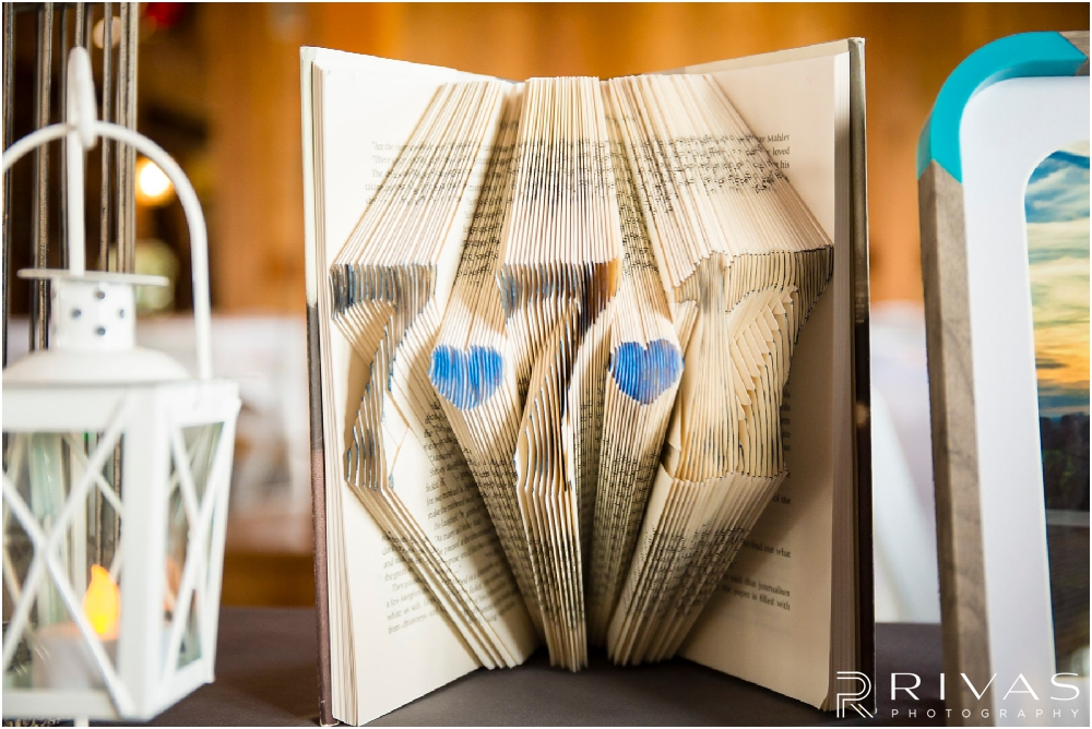 Mildale Farm Summer Wedding | An up-close image of a carved book sitting on the gift table during a Mildale Farm Summer Wedding Reception.