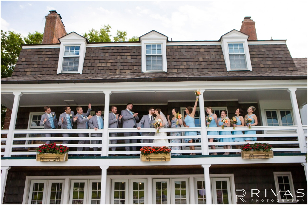 Mildale Farm Summer Wedding | A candid image of a bride and groom with their wedding party standing on the deck of the house at Mildale Farm after their wedding.