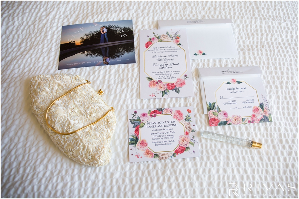 Staley Farms Golf Club Summer Wedding | A detailed photo of a couple's save the date and wedding invitations with a bride's clutch and perfume.
