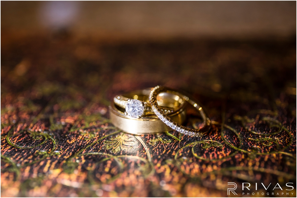 Staley Farms Golf Club Summer Wedding | A close-up picture of a bride and groom's engagement ring and wedding bands sitting on a journal written by the groom.