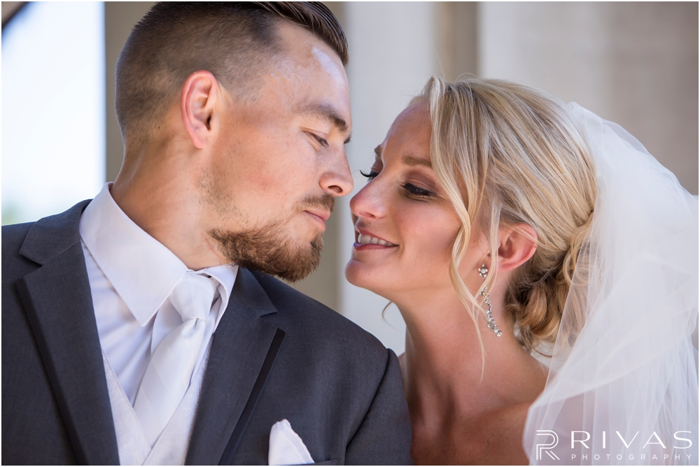 Staley Farms Golf Club Summer Wedding | A close-up picture of a bride and groom embracing after their wedding ceremony at The Colonnade in northeast Kansas City.
