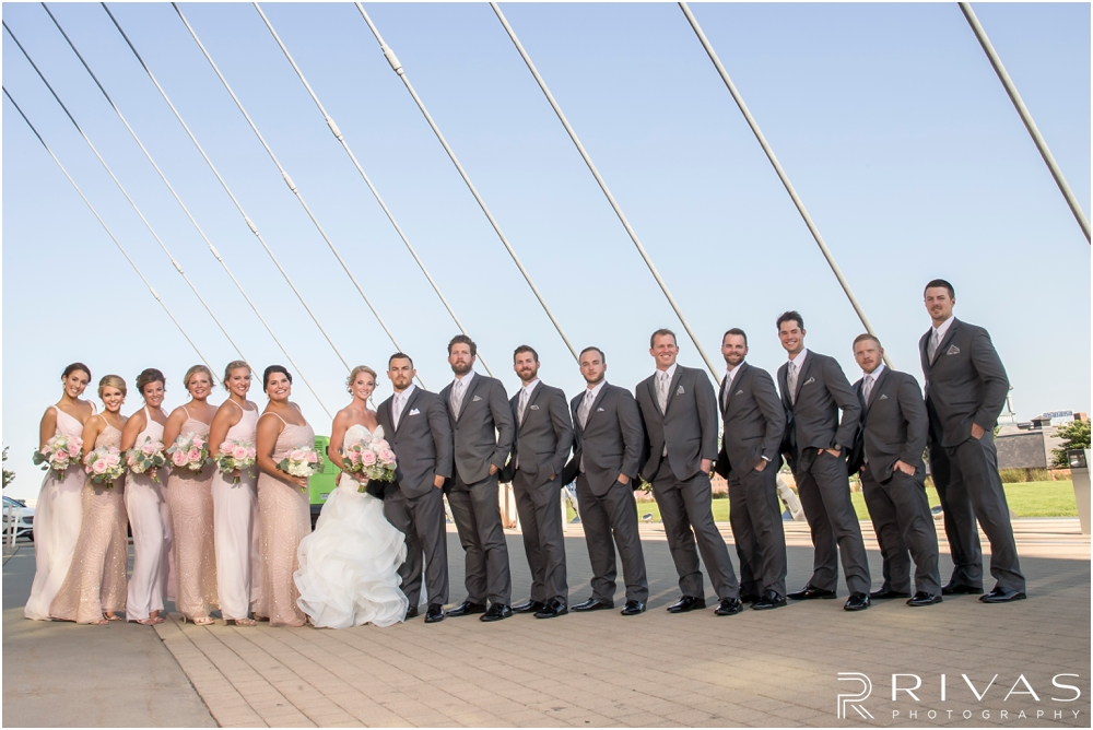 Staley Farms Golf Club Summer Wedding | A formal portrait of a bride and groom with their wedding party at the Kauffman Center for the Performing Arts  after their wedding in Kansas City.