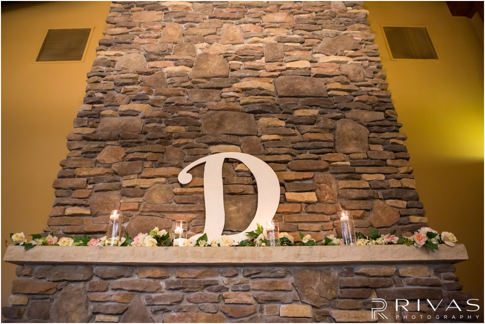 Staley Farms Golf Club Summer Wedding | A photo of a decorated fireplace at a wedding reception held at Staley Farms Golf Club in Kansas City.