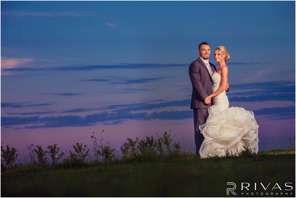Staley Farms Golf Club Summer Wedding | A dramatic sunset portrait of a bride and groom embracing taken during their wedding reception held at Staley Farms Golf Club in Kansas City.