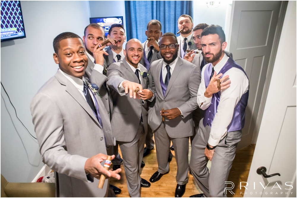 Belvoir Winery Romantic Summer Wedding | A candid picture of a groom and his groomsmen on the morning of his wedding day at Belvoir Winery in Liberty, MO.