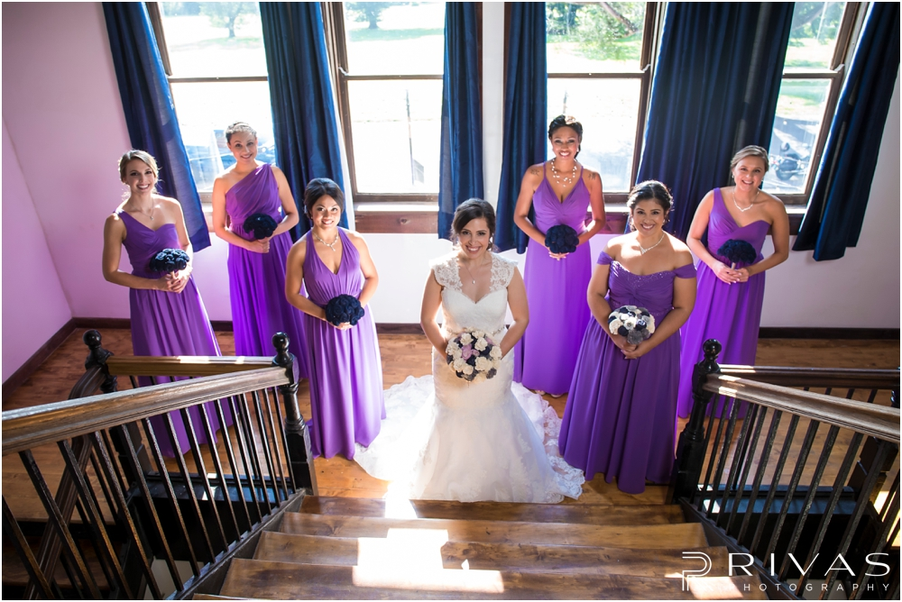 Belvoir Winery Romantic Summer Wedding | A picture of a bride and her bridesmaids in purple gowns on her wedding day at Belvoir Winery in Liberty, MO.