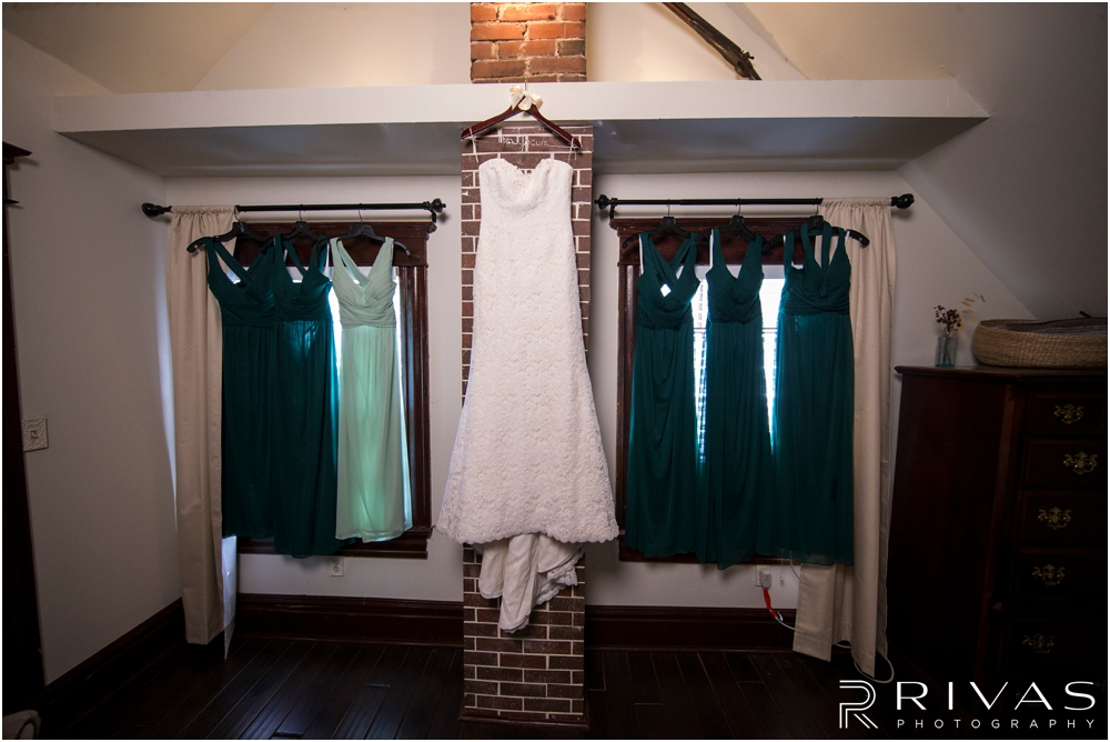 Classic Summer Wedding at Berg Event Space | A styled picture of a bride's gown with her bridesmaid dresses.