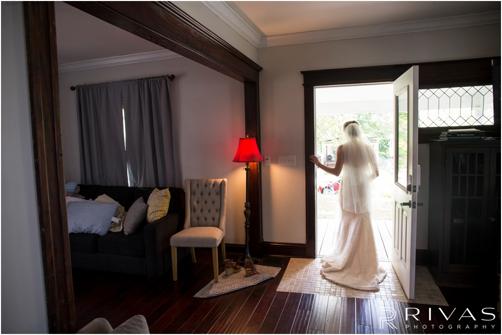 Classic Summer Wedding at Berg Event Space | A candid picture of a bride leaving a house on the morning of her wedding.