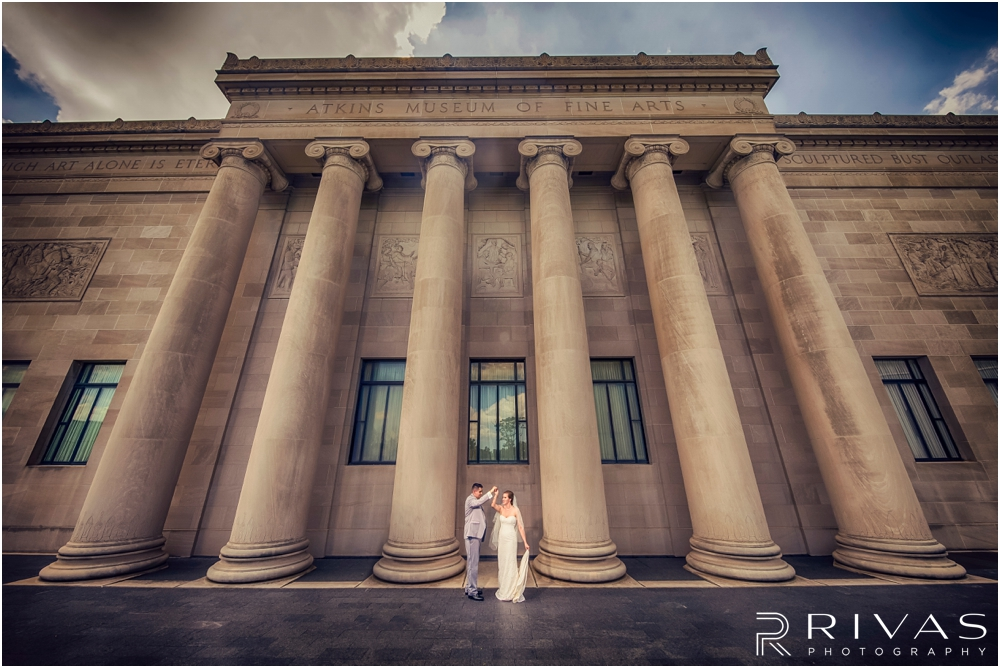 Classic Summer Wedding at Berg Event Space | A dramatic portrait of a bride and groom embracing on their wedding day in the gardens at The Nelson Atkins Museum of Art in Kansas City.