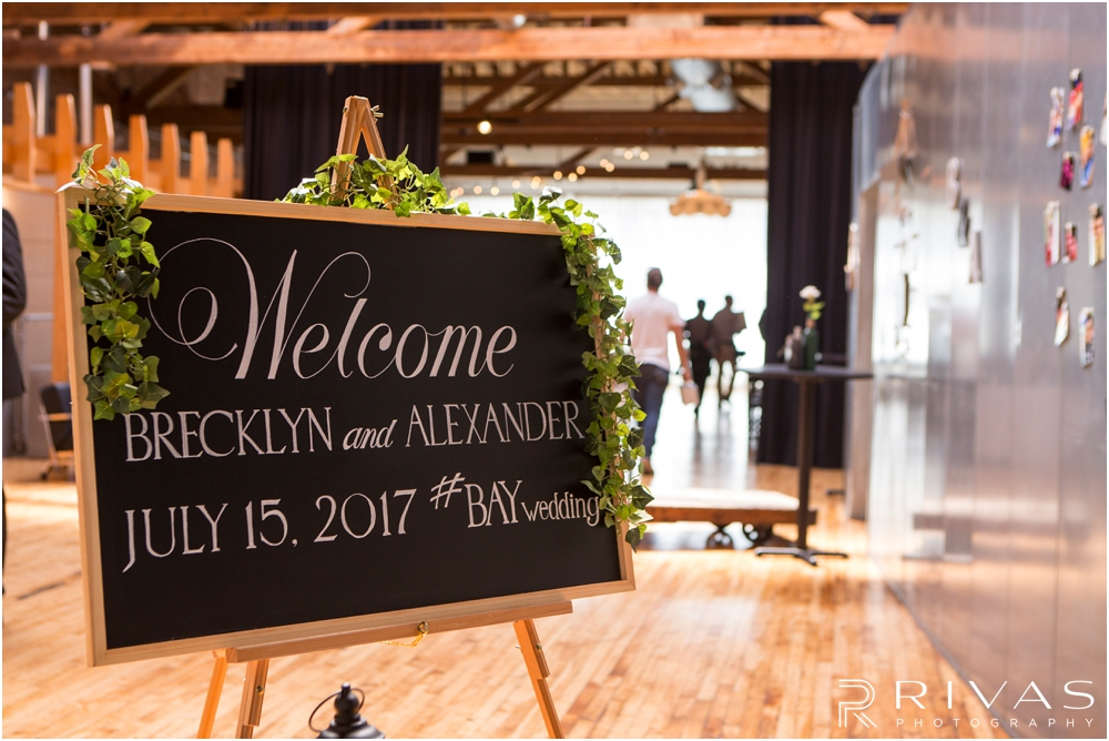 Classic Summer Wedding at Berg Event Space | A welcome sign just inside the Berg Event Space in Kansas City welcoming guests to a wedding and reception.