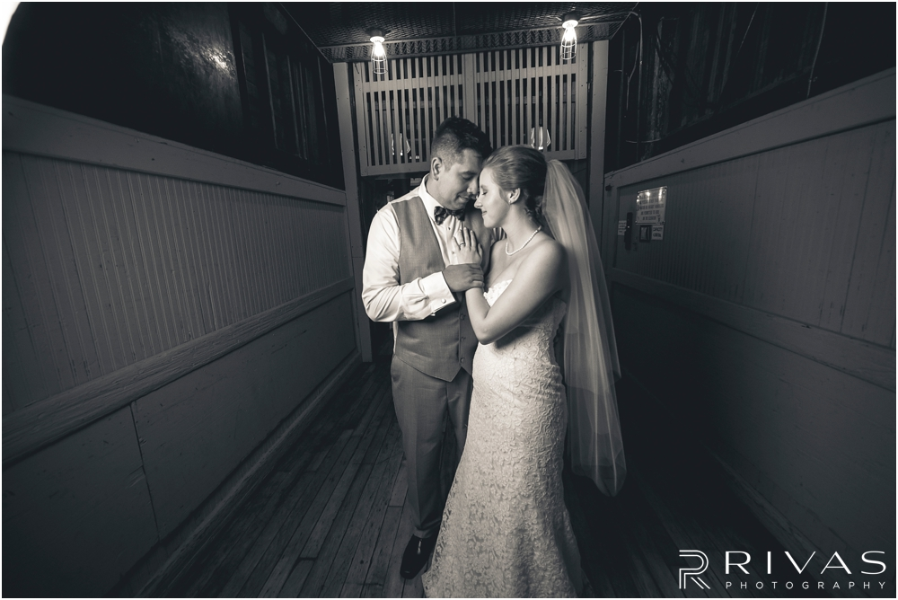Classic Summer Wedding at Berg Event Space | A black and white photo of a bride and groom embracing on the freight elevator at Berg Event Space in Kansas City.