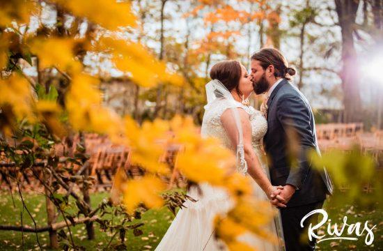 Schwinn Produce Farm Fall Wedding | Destination Wedding Photographers | A photo of a bride and groom sharing a kiss just after their first look on their wedding day.