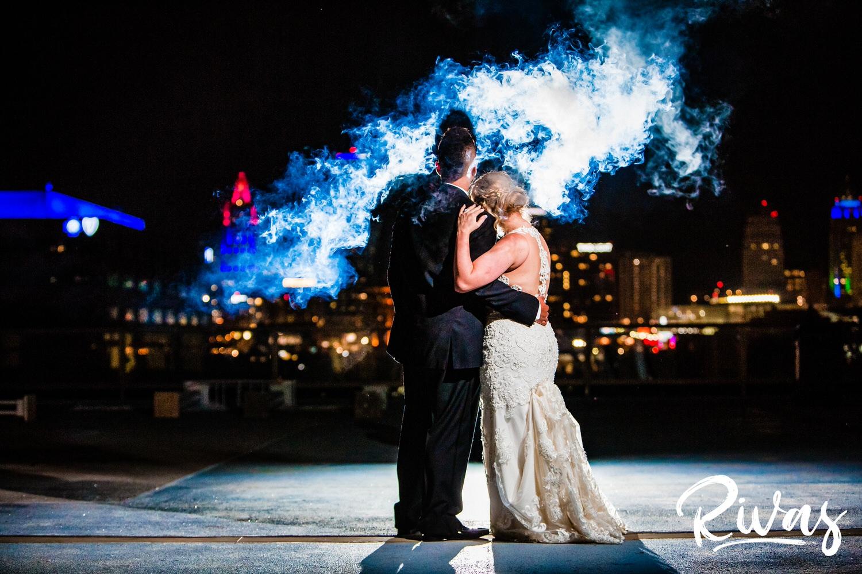 Kansas City Summer Skyline Wedding | Kansas City Wedding Photographers | A photo of a bride and groom overlooking the Kansas City skyline at the end of the their wedding night at the Westin crown Center.