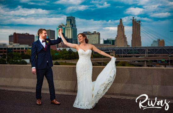 Strawberry Hil Summer Wedding Sneak Peek   A candid image of a bride and groom dancing in front of the Kansas City skyline taken from the Summit Street Bridge.