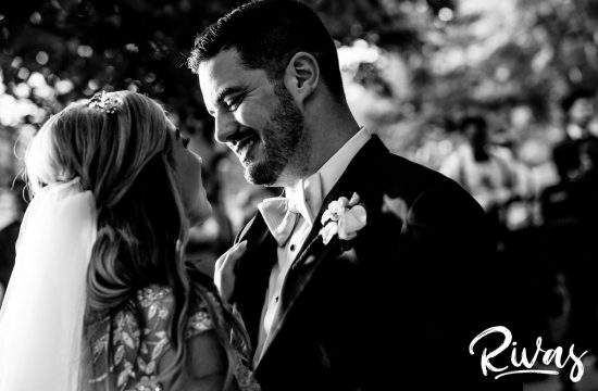 Elegant Lilac Summer Wedding | A groom looks into the his brides eyes on there wedding day