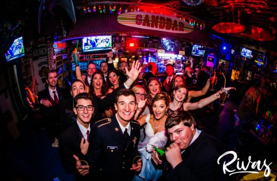 Tips For A Smooth Wedding Day | A young wedding party celebrating in a Lawrence Kansas bar