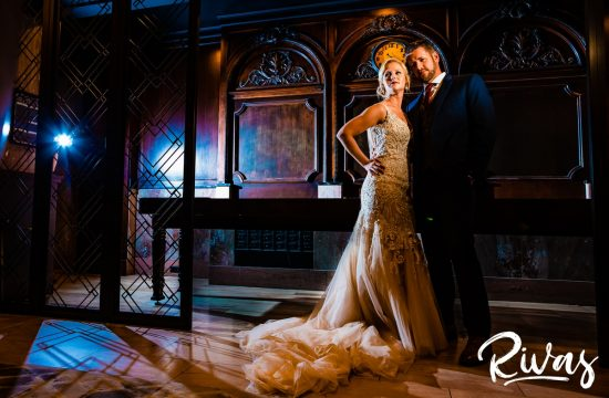 Art Deco Wedding Sneak Peek   Rivas   Kansas City Wedding Photographers   A dramatic portrait of a bride and groom embracing underneath a grided archway in Kansas City's Hotel Phillips on their wedding day.