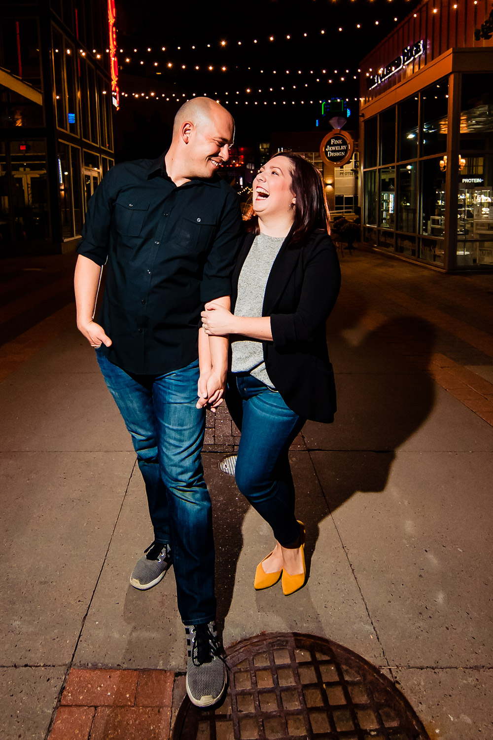 Rivas Weddings | A candid picture of Rivas owners Kyle Rivas and Melissa Rich in Kansas City's Power and Light District.