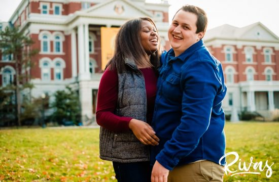 Fall MU Engagement Sneak Peek | KC Wedding Photography | Rivas | a candid picture of an engaged couple sharing an embrace and laughing together standing on the quad in front of Jesse Hall at the University of Missouri during their engagement session.