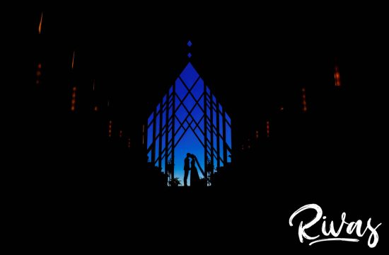 A colorful silhouette photo of a bride and groom sharing a kiss at the front of the Powell Gardens Chapel on their wedding day.
